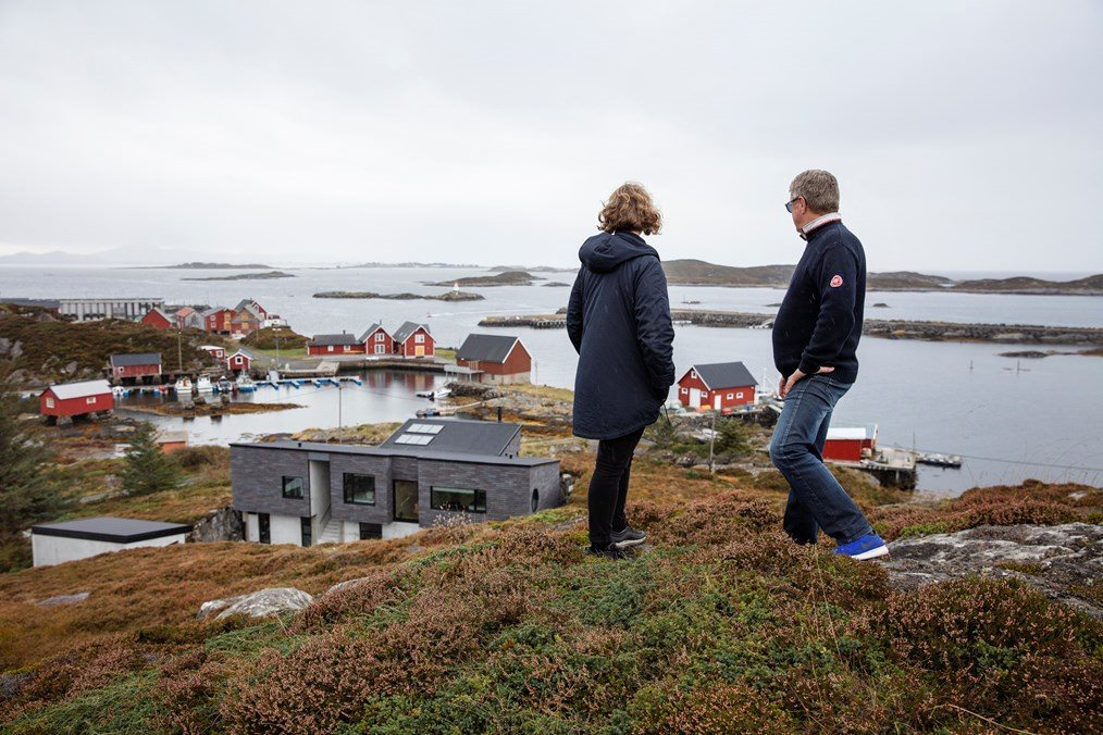 Architect Tone Sandøy and her father take in the view and their holiday home on Sandøya