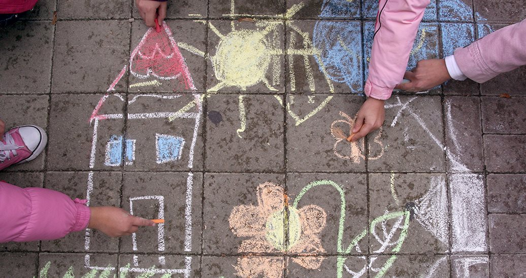 children sketching in chalk