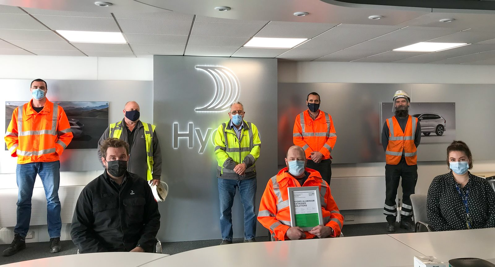 Employees at Hydro's Gloucester plant with social distance due to Covid19