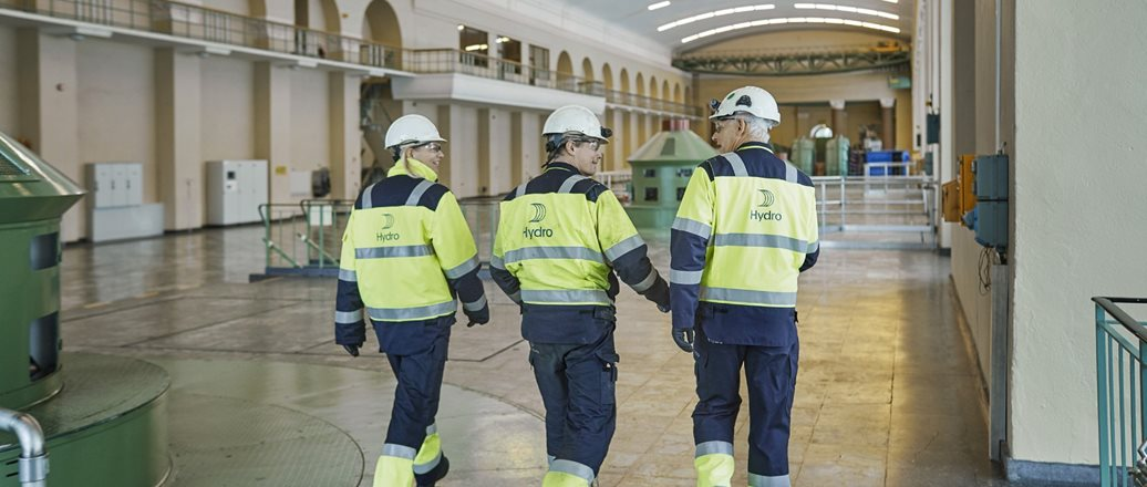 workers inside a large power station hall