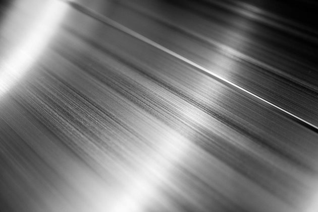Light playing across  the surface of extruded aluminum