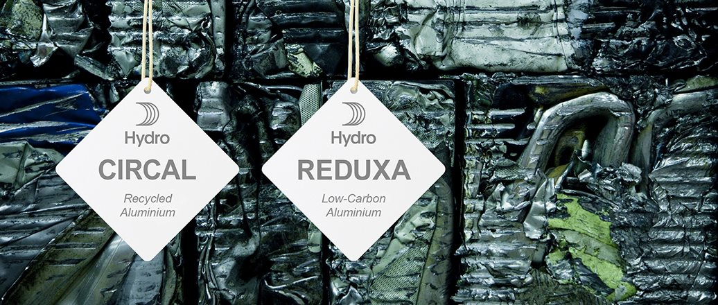 Hydro CIRCAL and Hydro REDUXA hangtags hanging on aluminium scrap