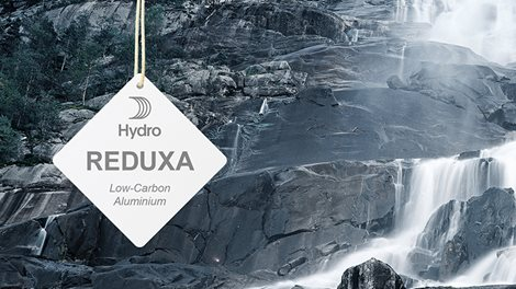 Hydro REDUXA hangtag hanging over a waterfall, mirroring the hydro-electric energy used to create the aluminium