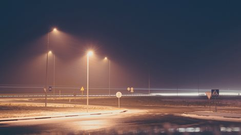 road lights, foggy evening in winter