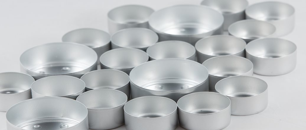 Empty tea light cups in aluminium