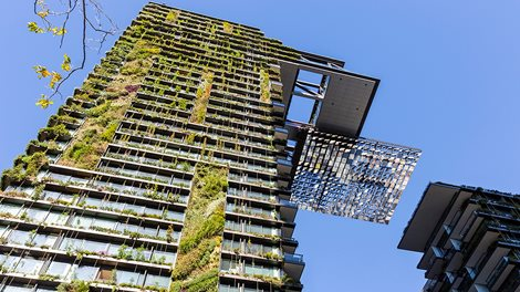 Low angle view of apartment building with vertical garden and heliostat
