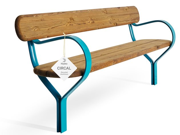 Park bench with wooden seat and back, metal feet, and an attached tag with Hydro CIRCAL logo
