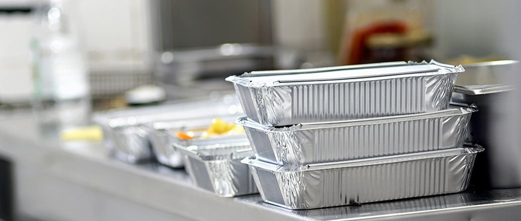 Take away food in foil boxes in Chinese restaurant kitchen