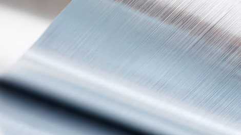 Close-up of a metallic sheet that is rolled up