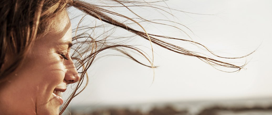 womain with long hair blowing in the wind