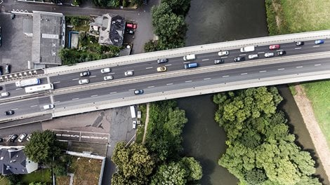 River and highway crossing a town, aerial view