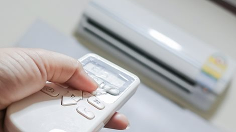 a remote control and reverse cycle air conditioner