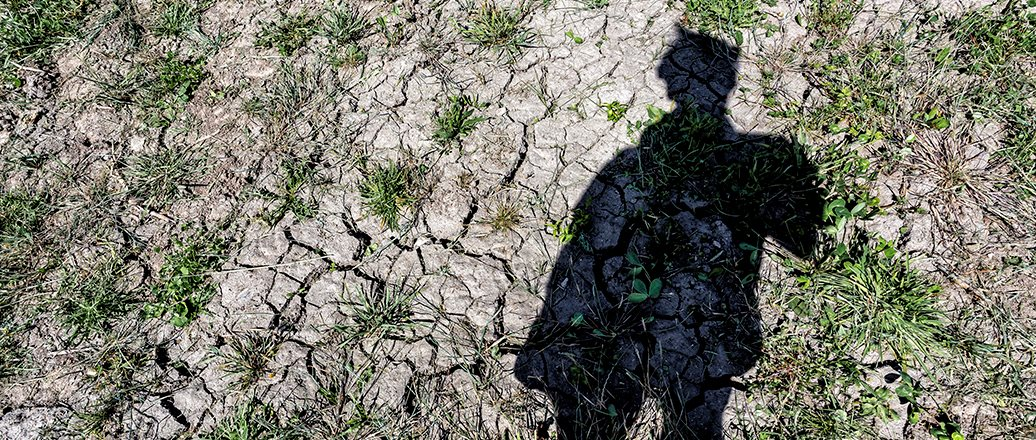 dry soil with shadow of a person
