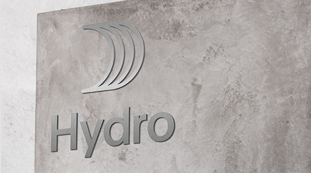 concrete wall with hydro sign in metal
