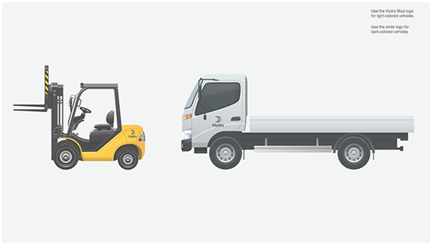 yellow forklift with small dark logo above rear wheels, lorry with logo centered on cab door.