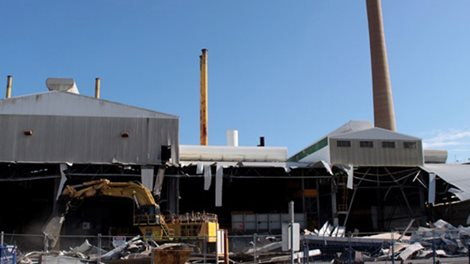 Exterior of factory buildings being demolished