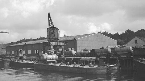 Warehouse and boats at dock, Menstad