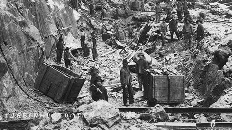 A group of workers doing construction work on a hillside.