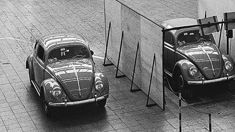 Three VW Beetles in an exhibition