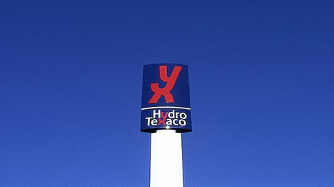 A sign with the Hydro Texaco common logo