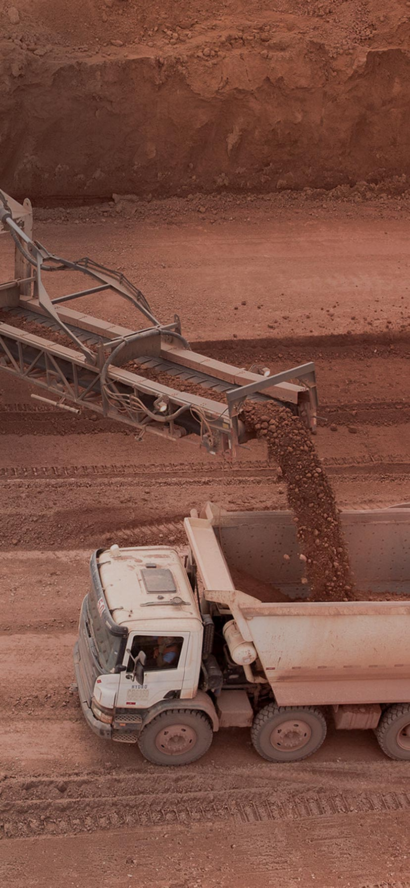 loading bauxite on truck