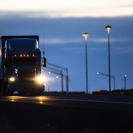 Large truck driving at night