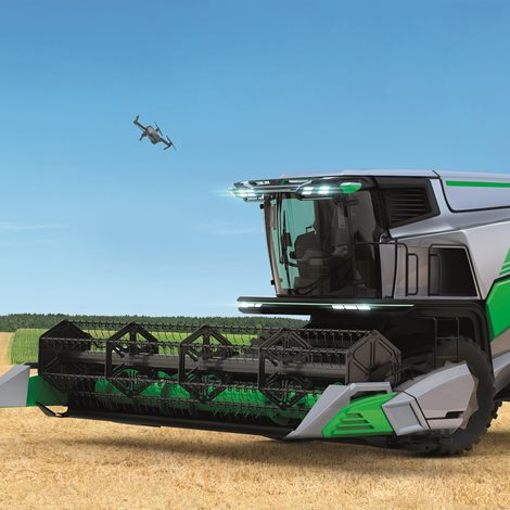 A futuristic harvester, observed by a small drone