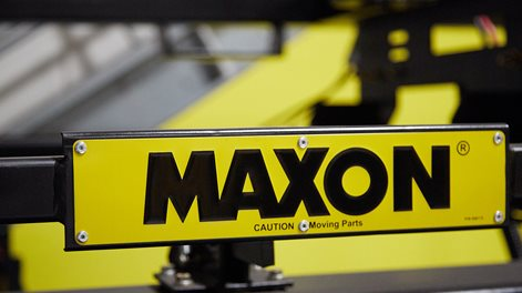 "maxon sign; ""caution, moving parts"""