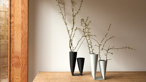 black and white vases on a table